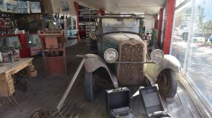 Old car in the old service station